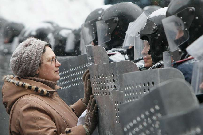 A woman addresses Ukrainian Interior Ministry troops who formed a battle line during the clashes. Gleb Garanich/Reuters